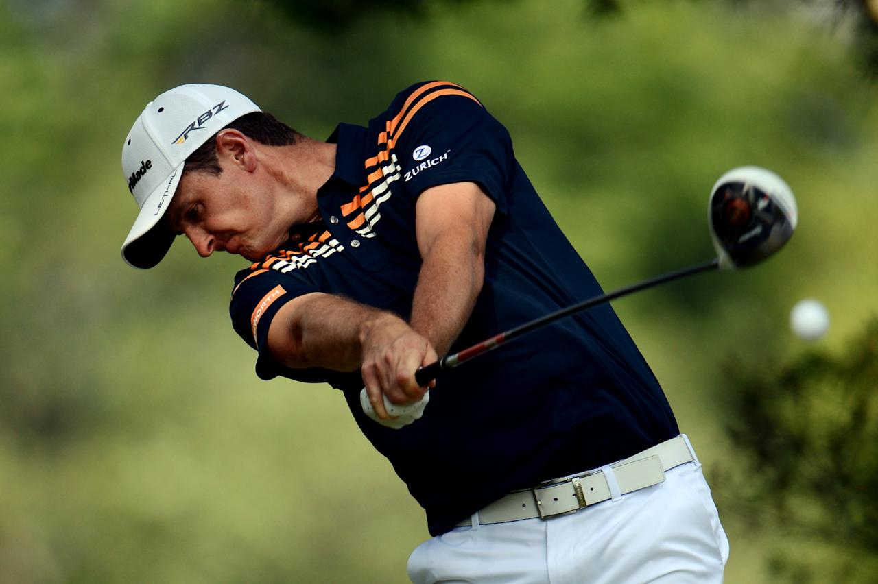 ARDMORE, PA - JUNE 14:  Justin Rose of England hits his tee shot on the fifth hole during Round Two of the 113th U.S. Open at Merion Golf Club on June 14, 2013 in Ardmore, Pennsylvania.  (Photo by David Cannon/Getty Images)