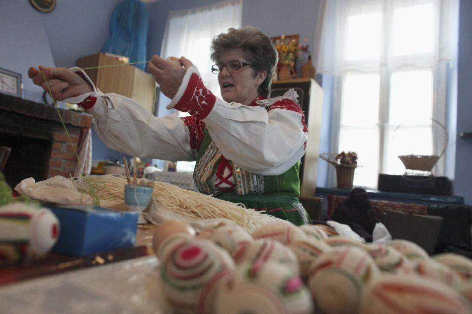 Helena Witkowska, a folk artist, decorates traditional Easter eggs at Kuznia Kurpiowska, a museum in the ethnic region of Kurpie in Pniewo, near Pultusk, 70 km (45 miles) north from Warsaw, April 4, 2012. In Kurpie, traditional Easter eggs are decorated with white bulrush pith and coloured wool, which are glued to the egg shell.