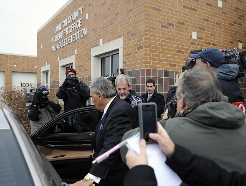 Attorney James Voyles, center left,  and Indianapolis Colts owner Jim Irsay, center right,  leave the Hamilton County Jail in Indianapolis, Monday, March 17, 2014. Irsay was released from jail Monday after being held overnight following a traffic stop in which police said he failed sobriety tests and had multiple prescription drugs inside his vehicle. Irsay was pulled over late Sunday after he was spotted driving slowly near his home in suburban Carmel, stopping in the roadway and failing to use a turn signal