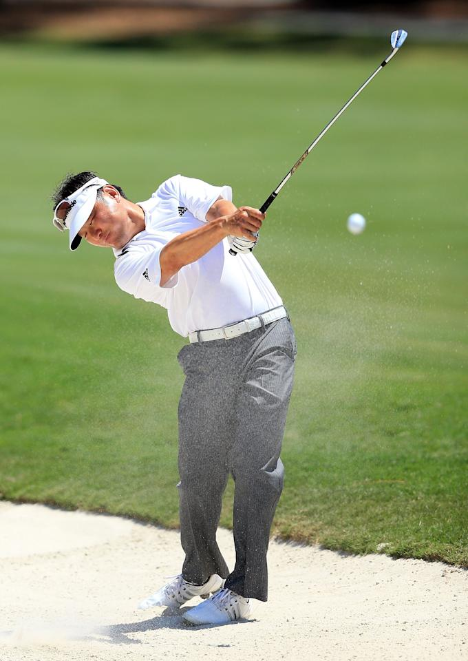 PONTE VEDRA BEACH, FL - MAY 10:  Charlie Wi of the USA plays his second shot at the par 4, 15th hole during the first round of THE PLAYERS Championship held at THE PLAYERS Stadium course at TPC Sawgrass on May 10, 2012 in Ponte Vedra Beach, Florida.  (Photo by David Cannon/Getty Images)