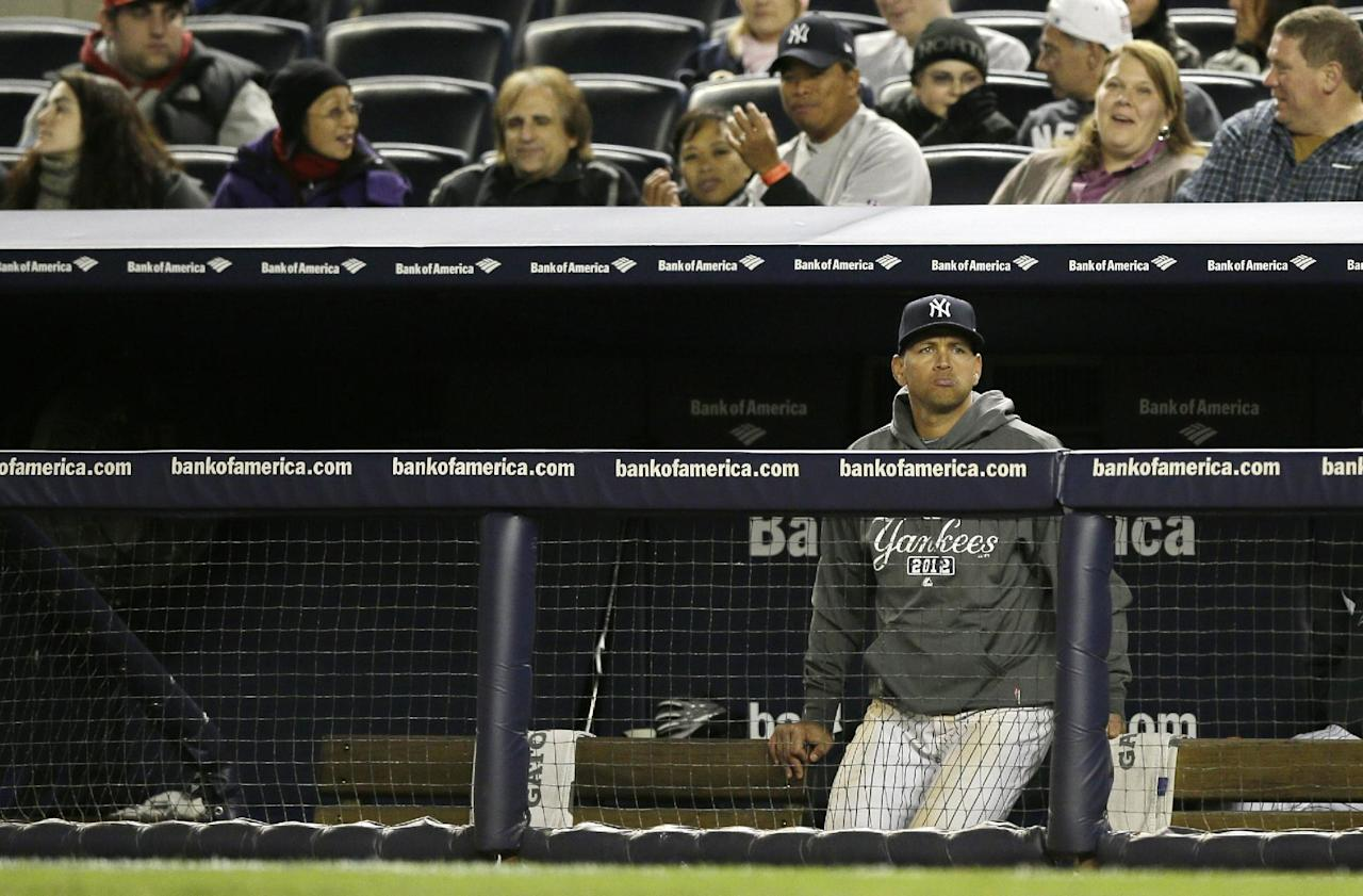 New York Yankees' Alex Rodriguez watches from the bench in the ninth inning of Game 1 of the American League championship series against the Detroit Tigers Saturday, Oct. 13, 2012, in New York. (AP Photo/Matt Slocum)
