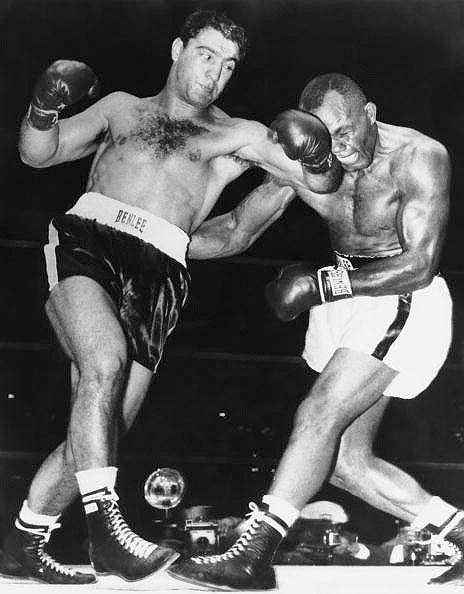 Rocky Marciano TKO13 Jersey Joe Walcott, Sept. 23, 1952 – This fight marked the start of Marciano's reign as heavyweight champion. He was far behind on points, but caught Walcott on the chin with a right cross that led to one of the great boxing photos of all-time. The photo showed the punch at the moment of impact, with Walcott's face grotesquely contorted.