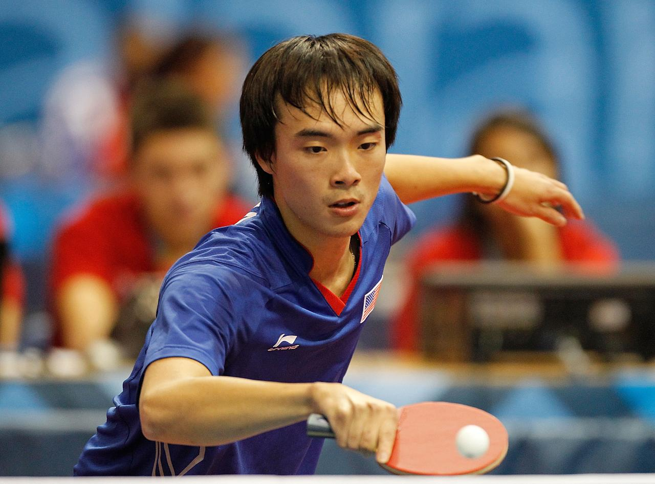 Timothy Wang of the USA plays a match against  Gustavo Tsuboi of Brazil at the Table Tennis during Day 2 of the XVI Pan American Games on October 16, 2011 in Guadalajara, Mexico.  (Photo by Mike Ehrmann/Getty Images)