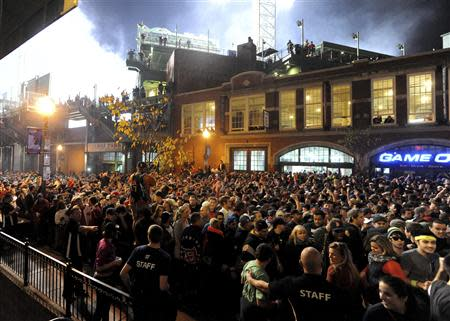 Fans gather after the Boston Red Sox won the MLB baseball's World Series at Landsdown Street near Fenway Park