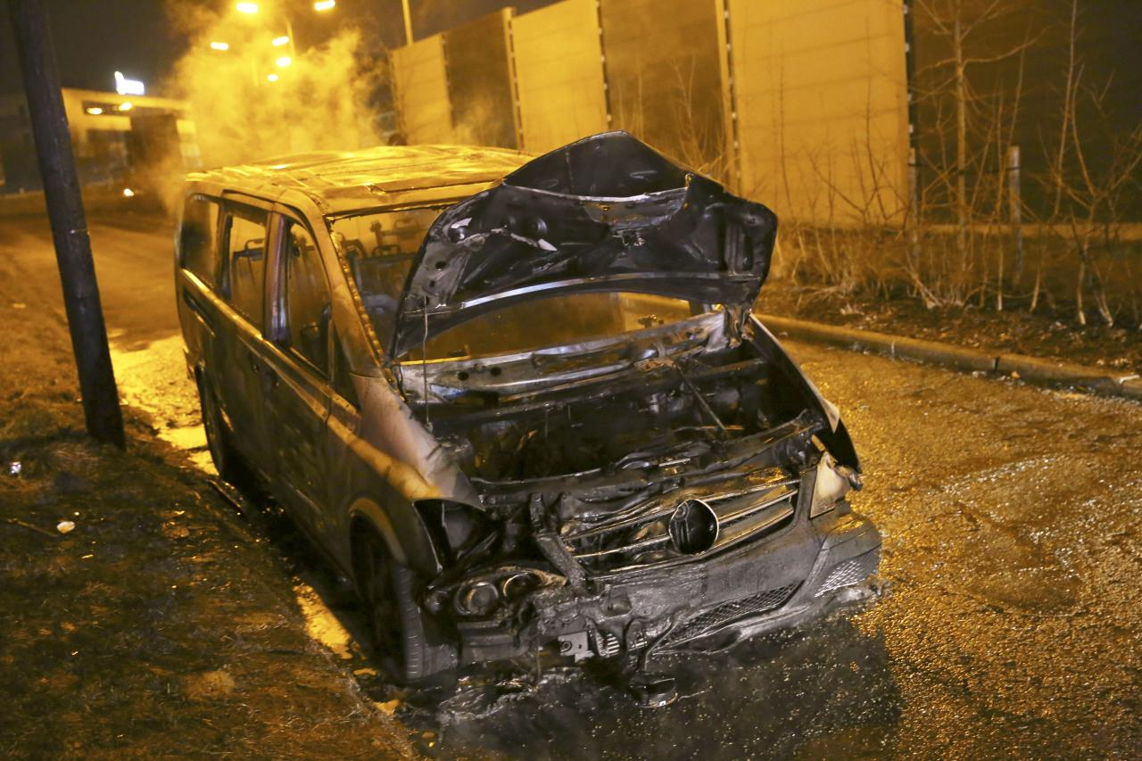 ZAVENTEM , BELGIUM - FEBRUARY 18: (BELGIUM OUT , FRANCE OUT , NETHERLANDS OUT) The burnt out remains of the van used in the heist near Brussels Airport on February 18, 2013 in Zaventem, Belgium. Using a van and car to break down the security fence a gang of robbers stole diamonds estimated to be worth 50 Million Euros from a security van. (Photo by Mozkito/Photonews via Getty Images)