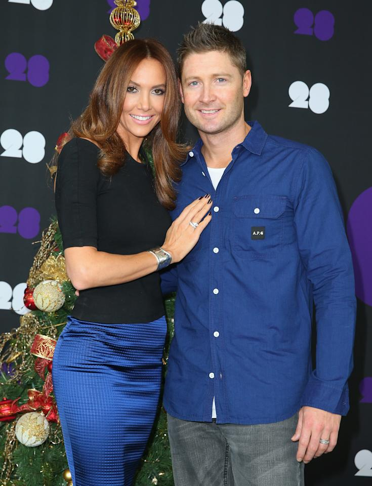 MELBOURNE, AUSTRALIA - DECEMBER 25:  Michael Clarke of Australia poses with his wife Kyly Clarke ahead of the Cricket Australia Christmas Day Lunch at Crown Metropol on December 25, 2013 in Melbourne, Australia.  (Photo by Scott Barbour/Getty Images)