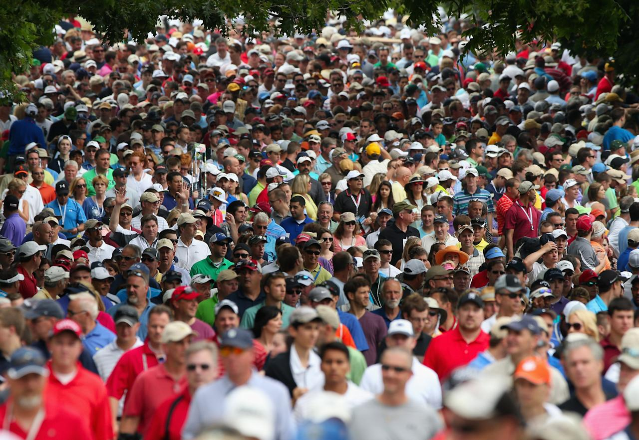 ARDMORE, PA - JUNE 16:  A gallery of patrons follow Tiger Woods of the United States and Matt Bettencourt of the United States near the second hole during the final round of the 113th U.S. Open at Merion Golf Club on June 16, 2013 in Ardmore, Pennsylvania.  (Photo by Andrew Redington/Getty Images)
