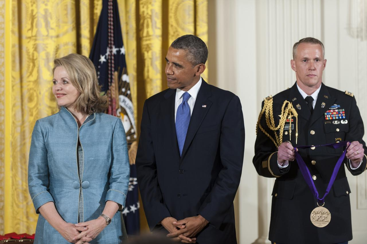 WASHINGTON, DC - JULY 10: U.S. President Barack Obama (C) presents a 2012 National Medal of Arts to Renee Fleming (L) for her contributions to American music, during a ceremony in the East Room of the White House on July 10, 2013 in Washington, DC. Fleming has captivated audiences around the world with a repertoire spanning opera, classical, jazz and contemporary pop. (Photo by Pete Marovich/Getty Images)