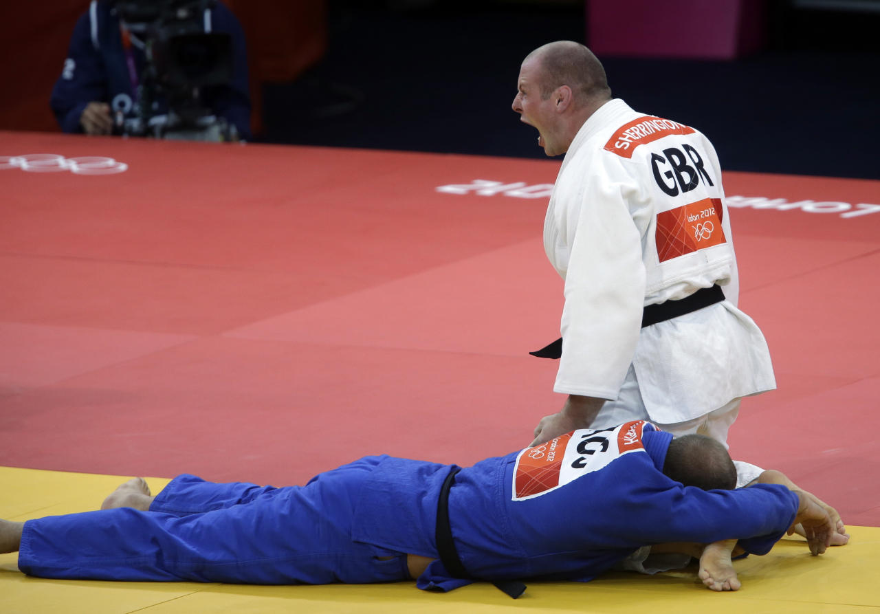 Great Britain's Christopher Sherrington reacts after defeating Australia's Jake Andrewartha during the elimination round of 32 at men's 100-kg judo at the 2012 Summer Olympics, Friday, Aug. 3, 2012, in London. (AP Photo/Mike Groll)