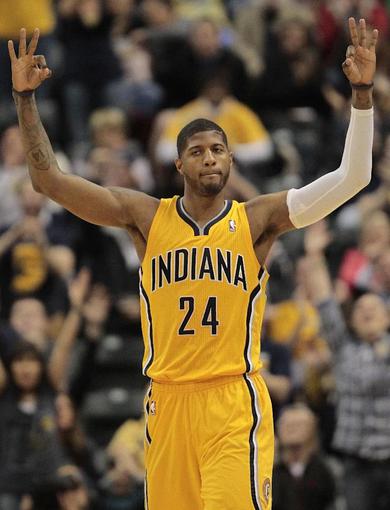 Indiana Pacers forward Paul George reacts to hitting a 3-point shot against the Detroit Pistons during the first half of an NBA basketball game in Indianapolis, Wednesday, April 2, 2014