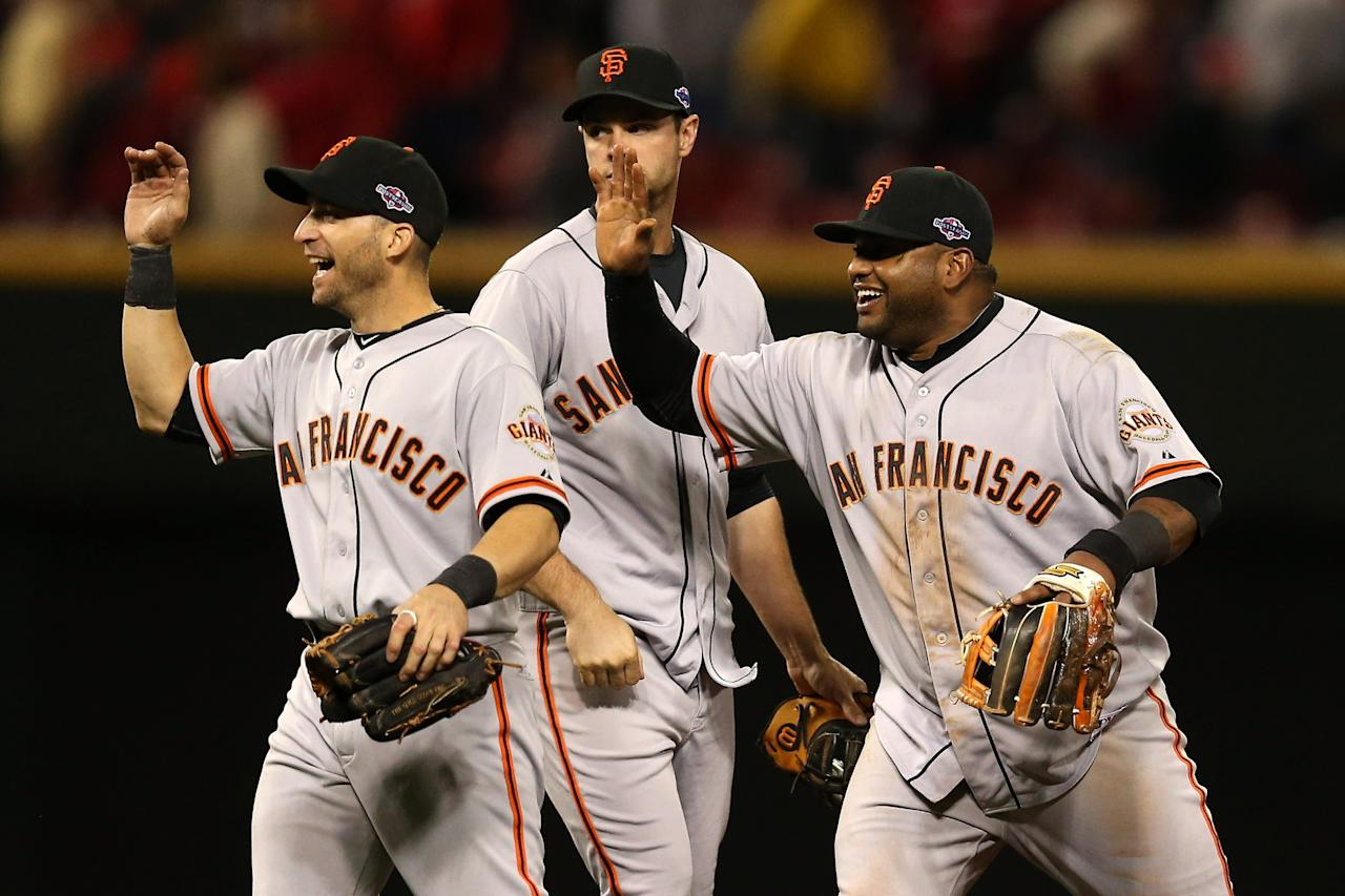CINCINNATI, OH - OCTOBER 09:  Pablo Sandoval #48, Brandon Belt #9 and Marco Scutaro #19 of the San Francisco Giants celebrate the Giants 2-1 victory in the 10th inning against the Cincinnati Reds in Game Three of the National League Division Series at the Great American Ball Park on October 9, 2012 in Cincinnati, Ohio.  (Photo by Jonathan Daniel/Getty Images)
