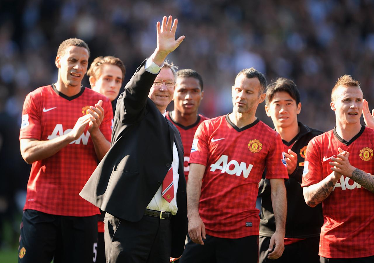 WEST BROMWICH, ENGLAND - MAY 19:  Manchester United manager Sir Alex Ferguson is applauded by players after his 1,500th and final match in charge of the club following the Barclays Premier League match between West Bromwich Albion and Manchester United at The Hawthorns on May 19, 2013 in West Bromwich, England.  (Photo by Michael Regan/Getty Images)