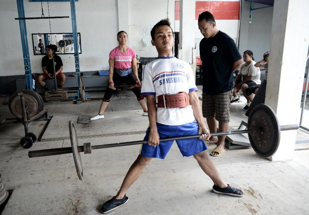 Weightlifting is gaining Indonesia large medal hauls in international competitions but lags behind badminton in popularity (AFP Photo/GOH Chai Hin)