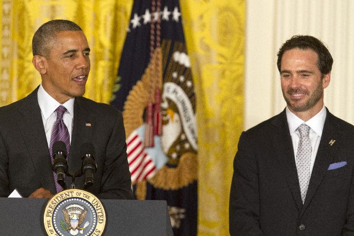 Jimmie Johnson listens as President Barack Obama speaks during a ceremony  in the East Room of the White House in Washington, Wednesday, June 25, 2014, to honor Johnson and Hendrick Motorsports for their 2013 NASCAR Sprint Cup Series championship