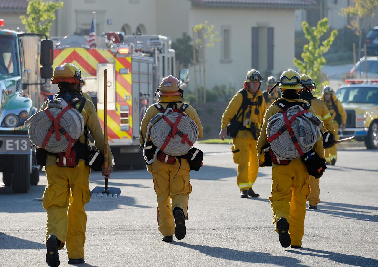NEWBURY PARK, CA - MAY 02:  Fire fighters prepare to take on an out of control wildfire on May 2, 2013 in Newbury Park, California.  Hundreds of firefighters are battling wind and dry conditions as over 6000 acres have already been burned northwest of Los Angeles.  (Photo by Kevork Djansezian/Getty Images)