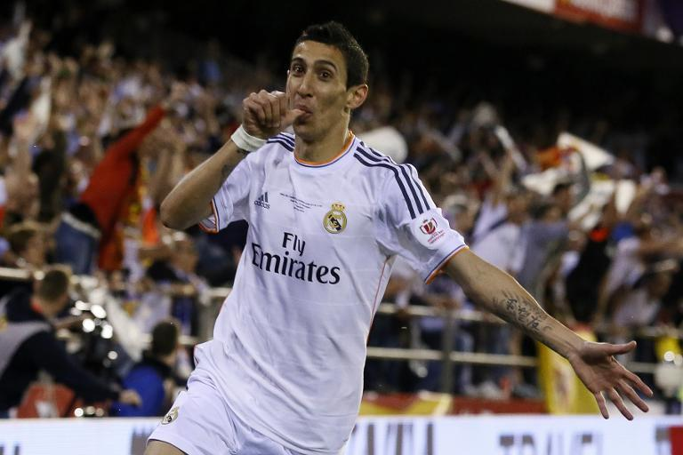 File picture taken on April 16, 2014 shows Argentina midfielder Angel di Maria celebrating after scoring for Real Madrid during the Spanish Copa del Rey final against Barcelona at the Mestalla Stadium in Valencia