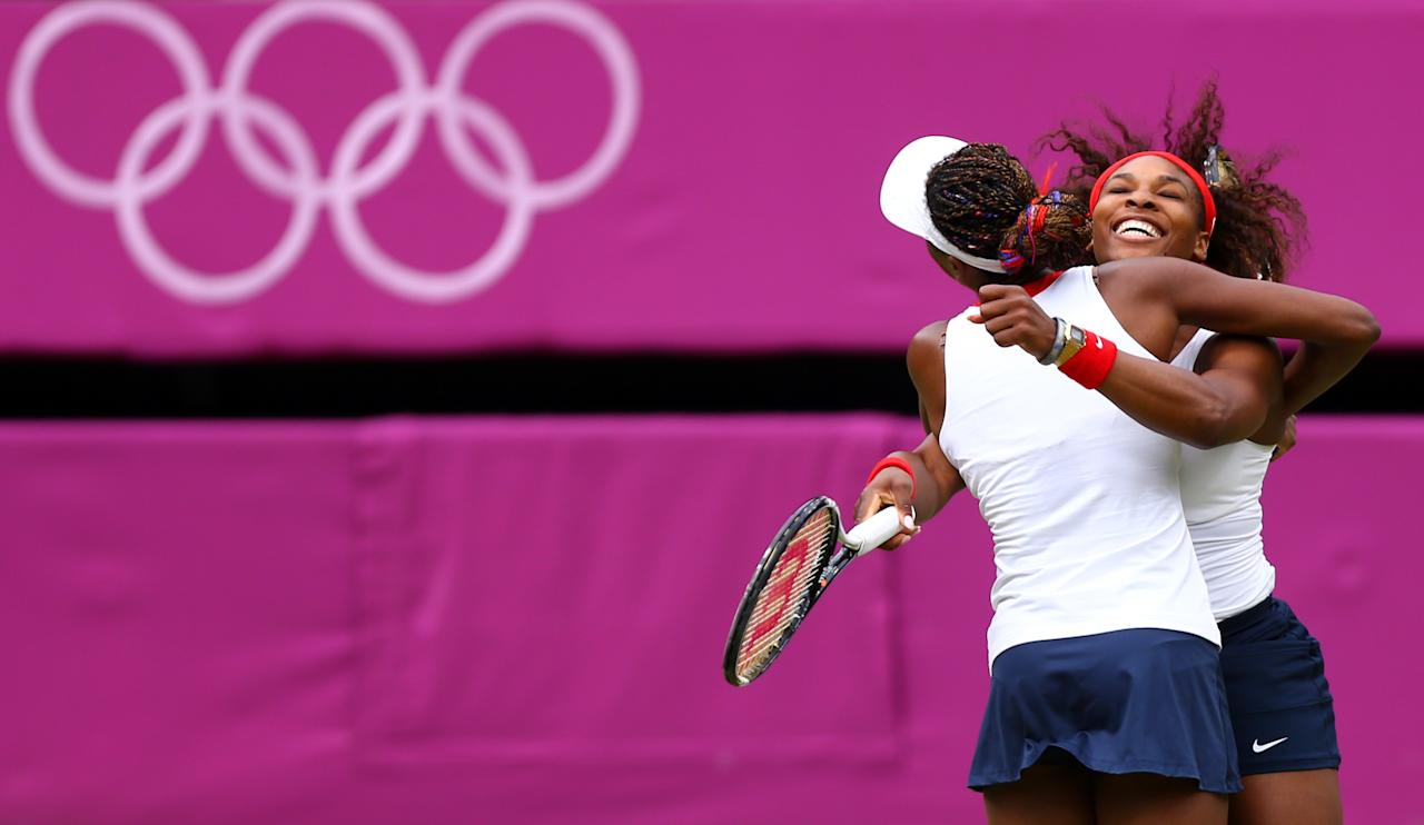 LONDON, ENGLAND - AUGUST 05:  Serena Williams (R) and Venus Williams (L) of the United States celebrate after defeating Andrea Hlavackova and Lucie Hradecka of Czech Republic in the Women's Doubles Tennis gold medal match on Day 9 of the London 2012 Olympic Games at the All England Lawn Tennis and Croquet Club on August 5, 2012 in London, England.  (Photo by Paul Gilham/Getty Images)