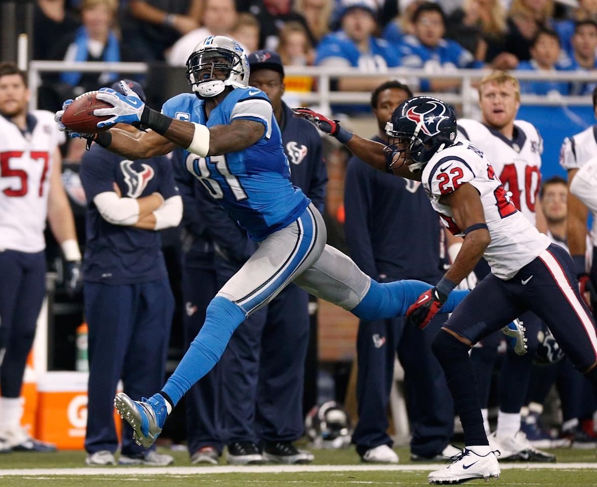 DETROIT, MI - NOVEMBER 22:  Calvin Johnson #81 of the Detroit Lions makes a second quarter catch in front of Alan Ball #22 of the Houston Texans at Ford Field on November 22, 2012 in Detroit, Michigan. (Photo by Gregory Shamus/Getty Images)