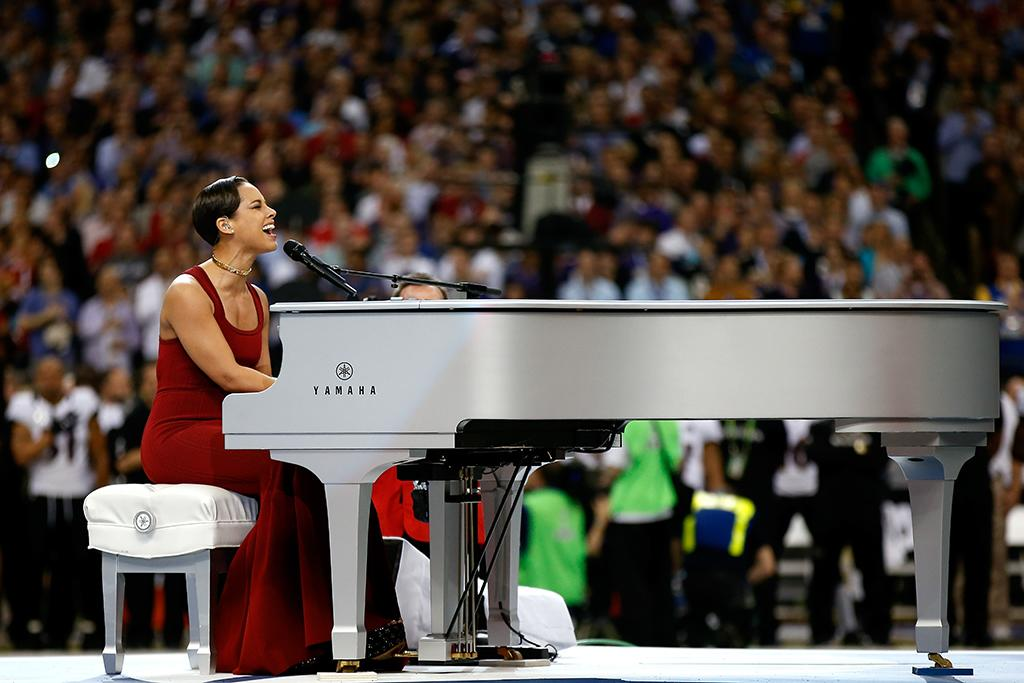 Alicia Keys performs the National Anthem prior to the start of Super Bowl XLVII between the Baltimore Ravens and the San Francisco 49ers at the Mercedes-Benz Superdome on February 3, 2013 in New Orleans, Louisiana.  (Photo by Chris Graythen/Getty Images)
