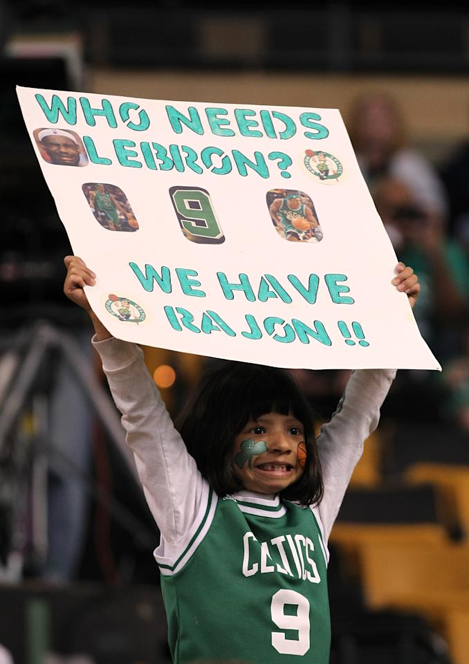 """BOSTON, MA - JUNE 03:  A young fan holds up a sign which reads """"Who needs LeBron we have Rajon!"""" prior to the Boston Celtics playing against the Miami Heat in Game Four of the Eastern Conference Finals in the 2012 NBA Playoffs on June 3, 2012 at TD Garden in Boston, Massachusetts. NOTE TO USER: User expressly acknowledges and agrees that, by downloading and or using this photograph, User is consenting to the terms and conditions of the Getty Images License Agreement.  (Photo by Jim Rogash/Getty Images)"""