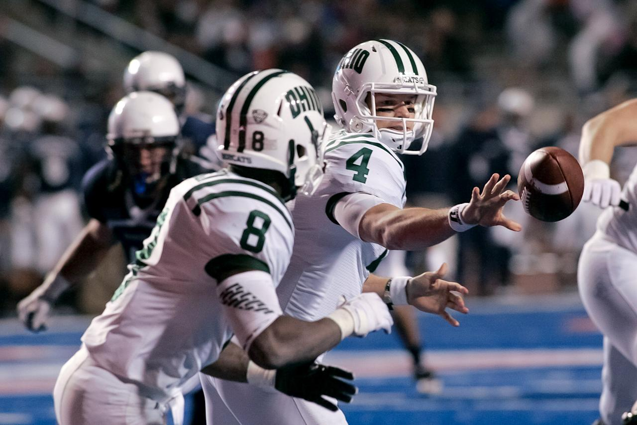 Tyler Tettleton #4 pitches the ball to Donte Harden #8 of the Ohio Bobcats during the game against the Utah State Aggies at Bronco Stadium on December 17, 2011 in Boise, Idaho.  (Photo by Otto Kitsinger III/Getty Images)