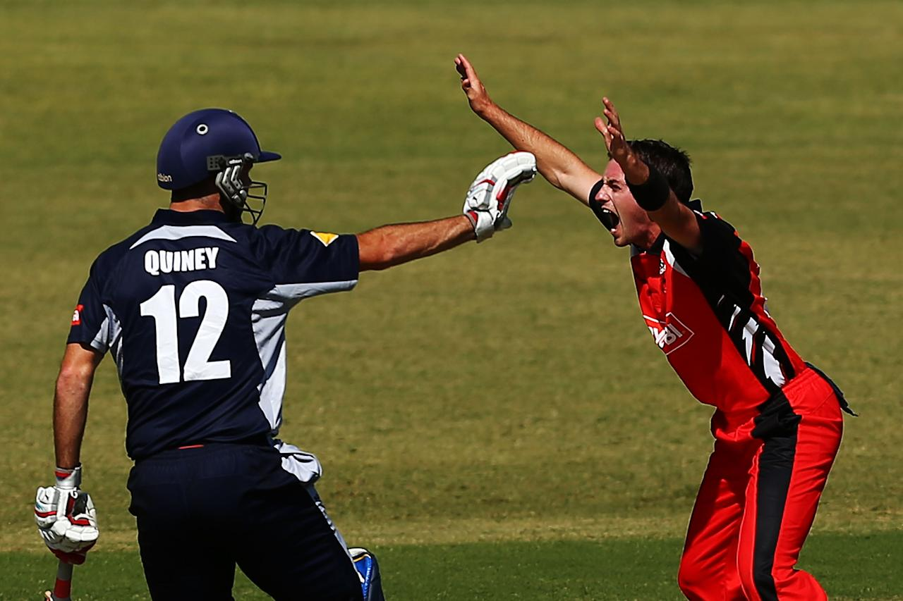 SYDNEY, AUSTRALIA - OCTOBER 04:  Chadd Sayers of the Redbacks appeals unsuccessfully for the wicket of Matthew Wade of the Bushrangers as Rob Quiney calls off a run during the Ryobi Cup match between the South Australia Redbacks and the Victoria Bushrangers at Bankstown Oval on October 4, 2013 in Sydney, Australia.  (Photo by Matt King/Getty Images)