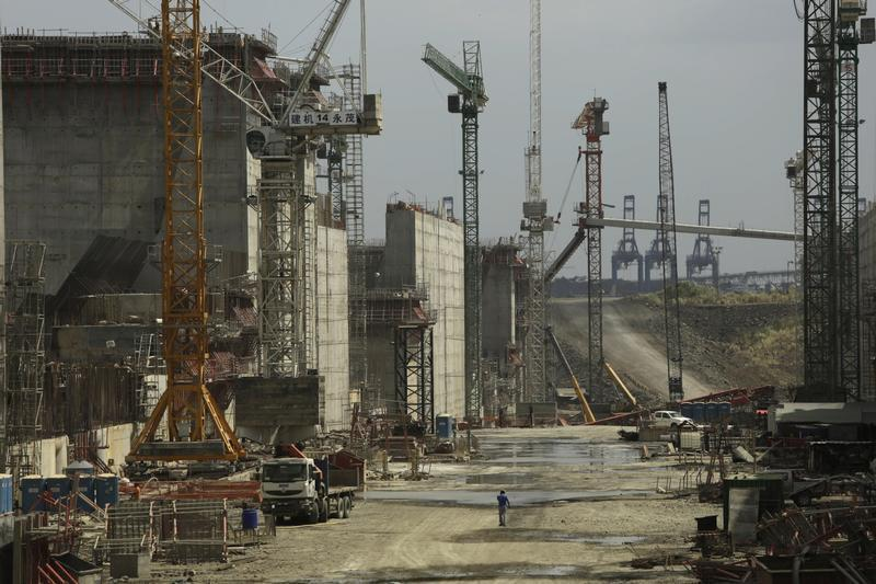 Man walks between cranes during a tour organized by the Panama Canal authorities of the Panama Canal Expansion project construction site on the Pacific side in Panama City