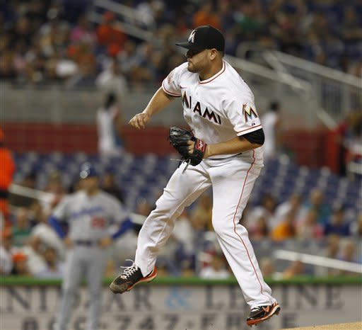 Miami Marlins starter Ricky Nolasco pitches to the Los Angeles Dodgers during the first inning of a baseball game in Miami, Saturday, Aug. 11, 2012. (AP Photo/J Pat Carter)