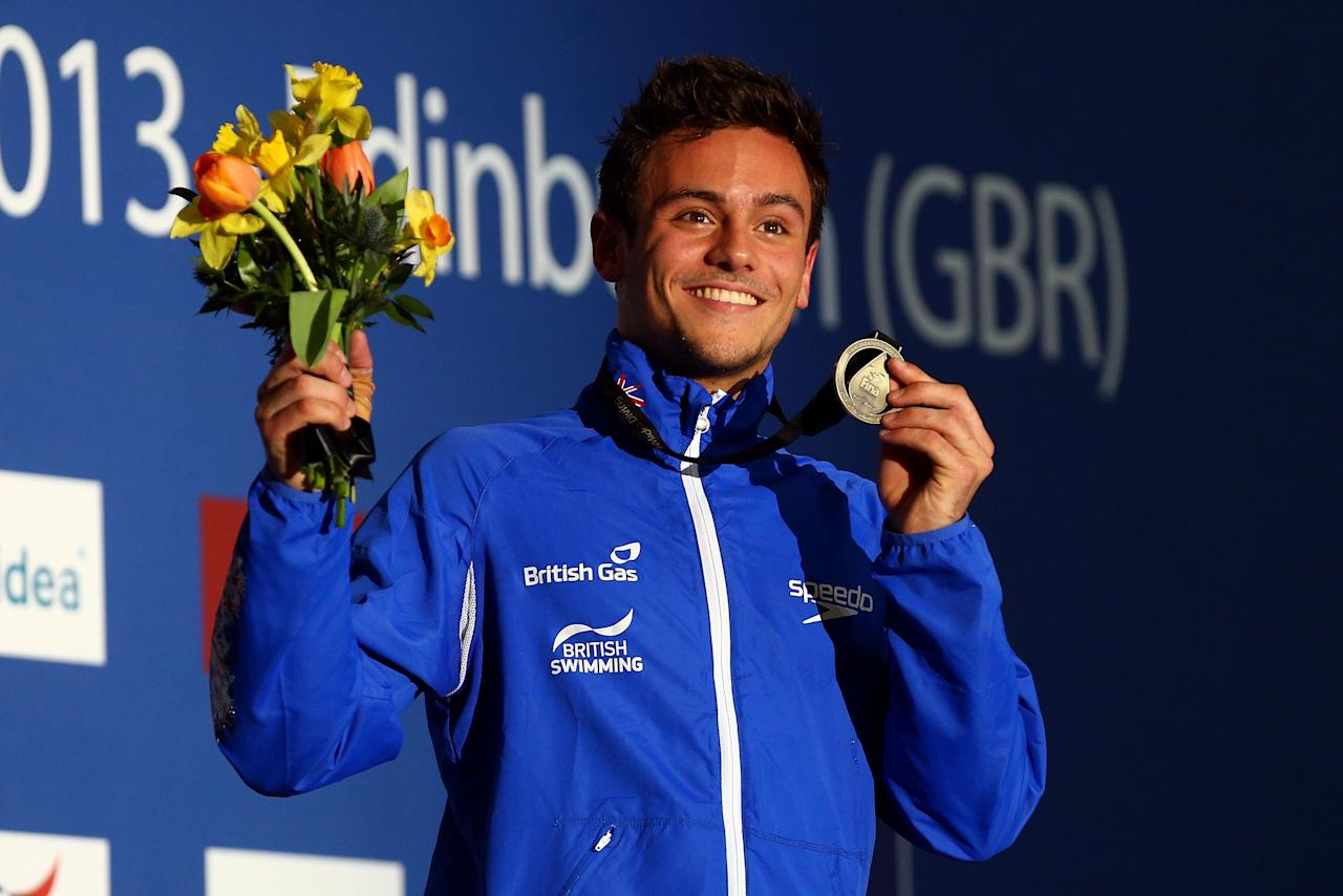 EDINBURGH, SCOTLAND - APRIL 21:  Tom Daley of Great Britain poses with his Gold medal on the podium after winning the Men's 10m Platform Final during day three of the FINA/Midea Diving World Series 2013 at the Royal Commonwealth Pool on April 21, 2013 in Edinburgh, Scotland.  (Photo by Clive Rose/Getty Images)