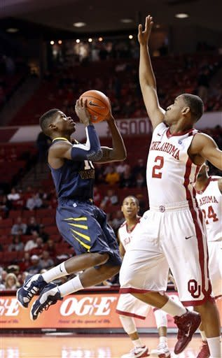 Sooners lead wire to wire again, top WVU 83-70