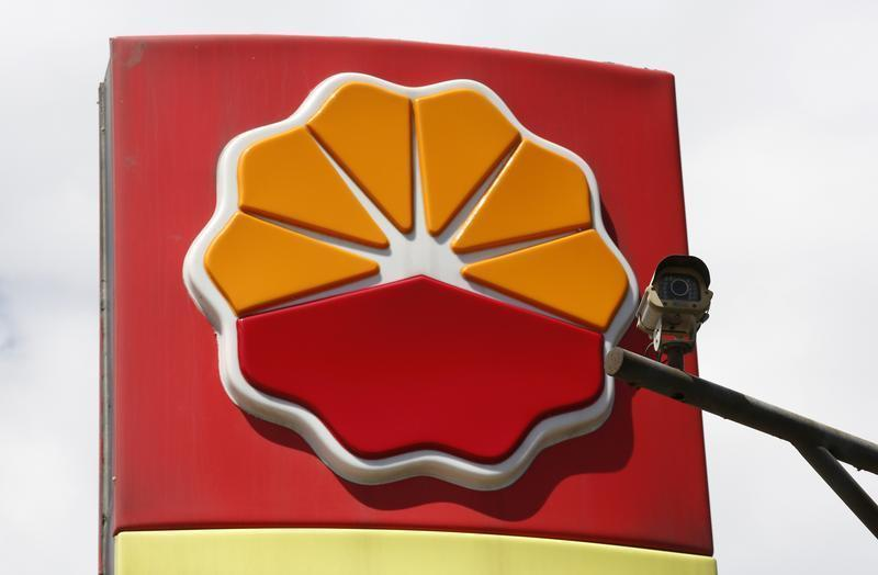 A security camera is seen in front of the logo of Petrochina in Beijing