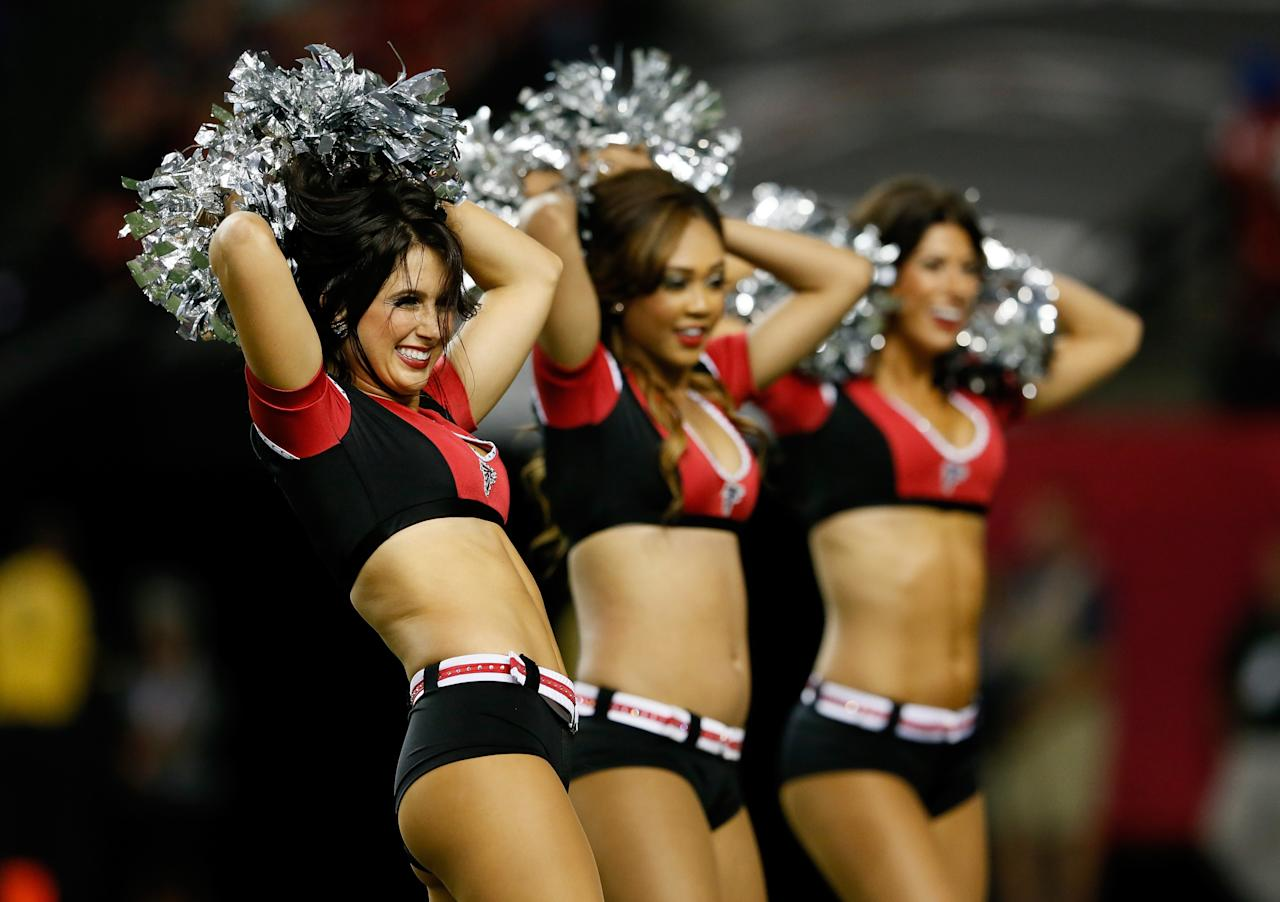 ATLANTA, GA - SEPTEMBER 29: The Atlanta Falcons cheerleaders perform during the game against the New England Patriots at Georgia Dome on September 29, 2013 in Atlanta, Georgia. (Photo by Kevin C. Cox/Getty Images)