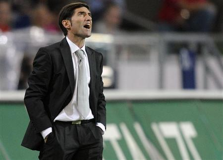 Sevilla's coach Marcelino Garcia Toral shouts during their Europa League playoff first leg soccer match against Hanover 96 in Hanover,