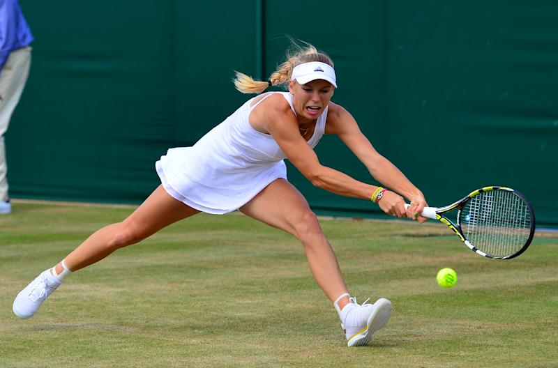 Denmark's Caroline Wozniacki returns to Czech Republic's Barbora Zahlavova Strycova during their women's singles fourth round match on day seven of the 2014 Wimbledon Championships, on June 30, 2014