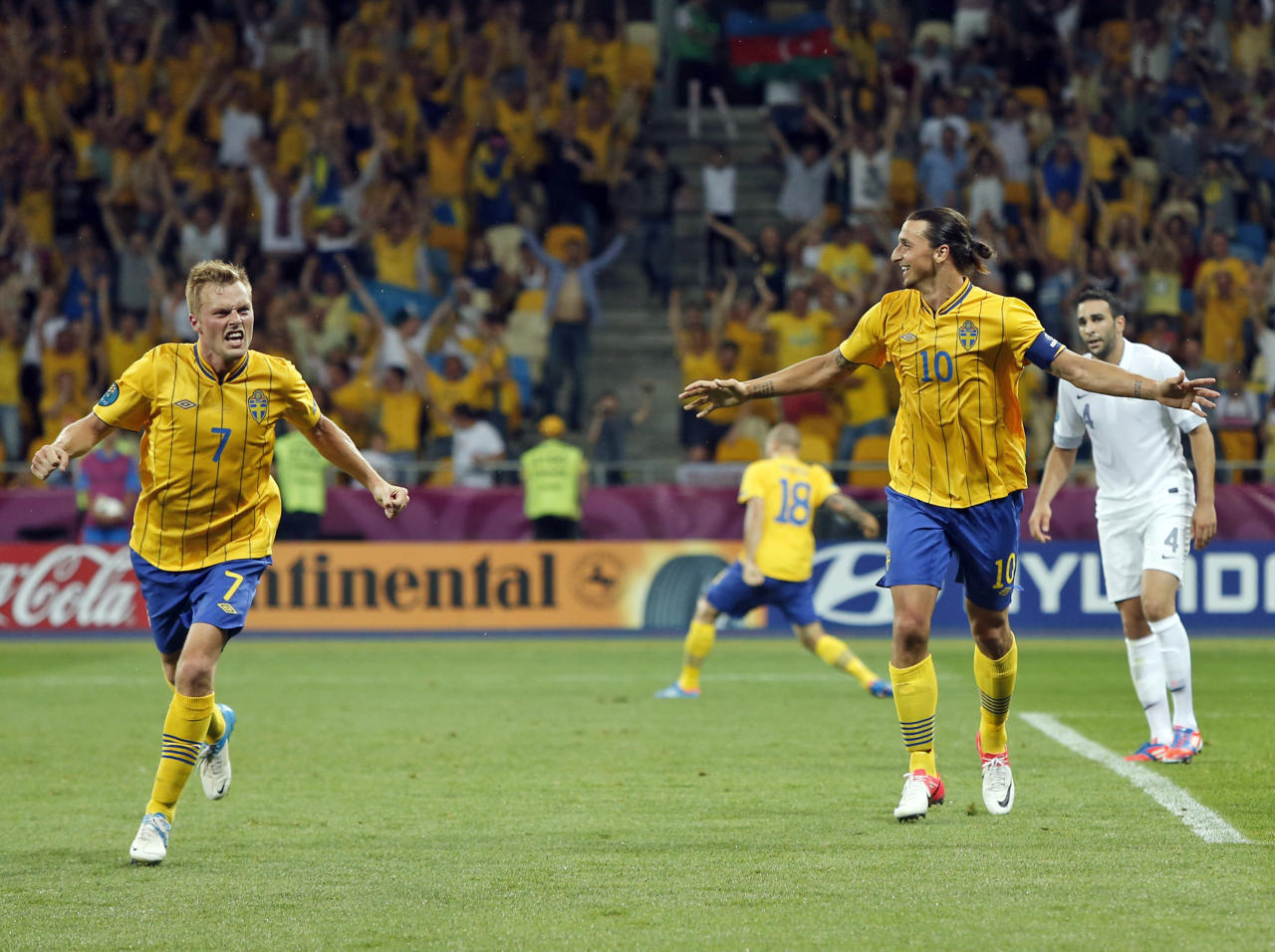 Sweden's Sebastian Larsson, left, and Zlatan Ibrahimovic celebrate the second goal during the Euro 2012 soccer championship Group D match between Sweden and France in Kiev, Ukraine, Tuesday, June 19, 2012. (AP Photo/Sergei Grits)