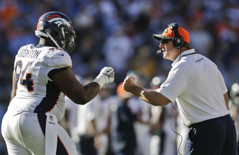 Manning throws 4 TD passes in Broncos' 28-20 win