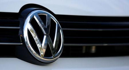 The logo of German car maker Volkswagen is seen on a car outside a garage in Vienna