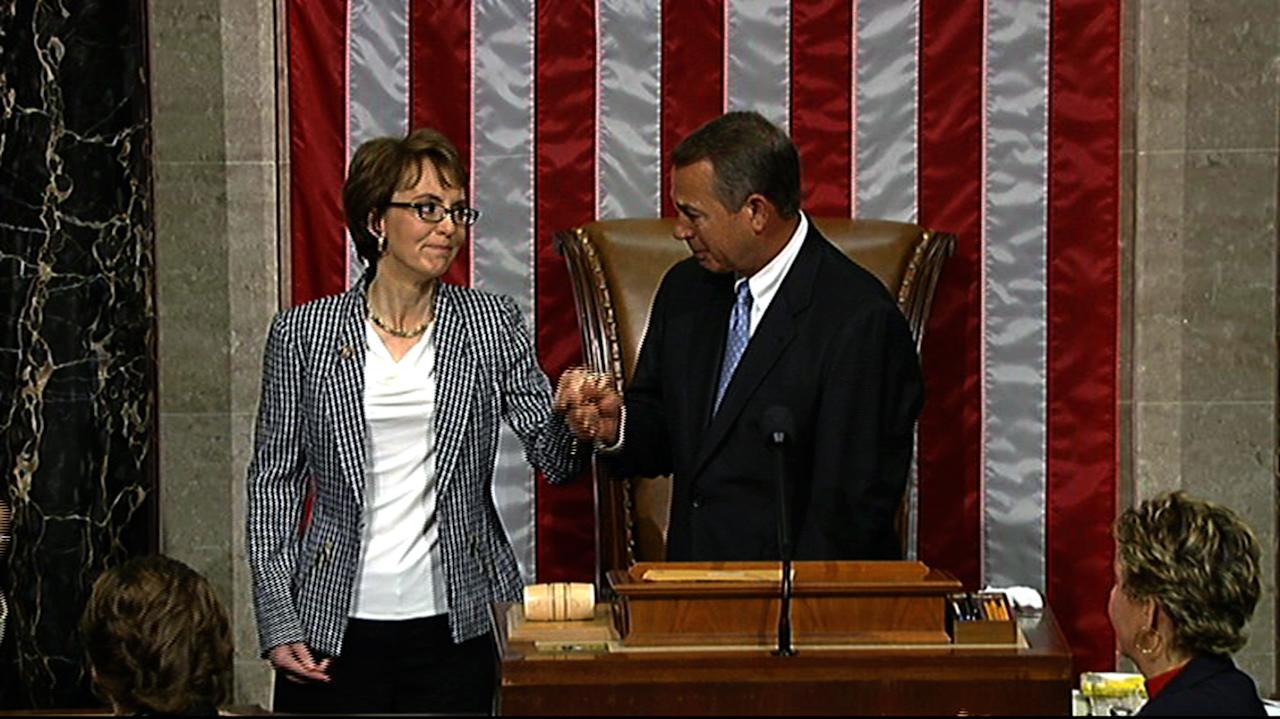 This video image provided by House Television shows Rep. Gabrielle Giffords, D-Ariz. and House Speaker John Boehner of Ohio, on the floor of the House on Capitol Hill in Washington, Wednesday, Jan. 25, 2012. Giffords resigned from the House on Wednesday amid tears, tributes and standing ovations, more than a year after she was gravely wounded by a would-be assassin. (AP Photo/House Television)