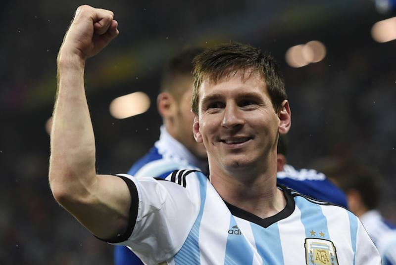 Argentina's forward and captain Lionel Messi celebrates after winning their FIFA World Cup semi-final match against the Netherlands in a penalty shoot-out following extra time at The Corinthians Arena in Sao Paulo on July 9, 2014