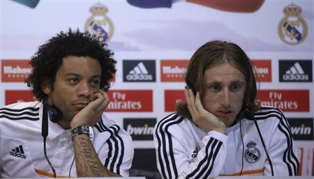 Real Madrid's Marcelo and Luka Modric attend a news conference to discuss the draw for the 2014 World Cup at the Valdebebas training grounds, outside Madrid