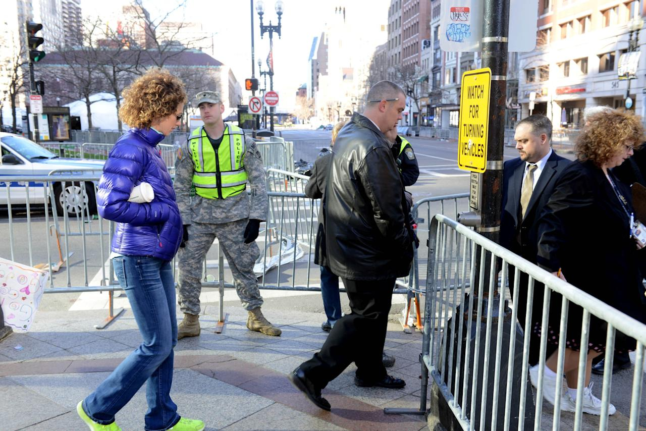 BOSTON - APRIL 16:  People walk along Clarendon Street and Boylston Street on April 16, 2013 in Boston, Massachusetts. Security is especially tight in the city of Boston after two explosions went off near the finish of the Marathon, killing three people and injuring at least 141 others. (Photo by Darren McCollester/Getty Images)