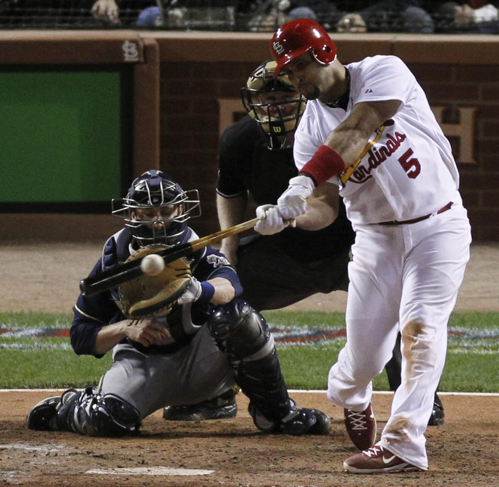 St. Louis Cardinals' Albert Pujols hits an RBI single during the sixth inning of Game 5 of baseball's National League championship series against the Milwaukee Brewers Friday, Oct. 14, 2011, in St. Louis. (AP Photo/Jeff Roberson)