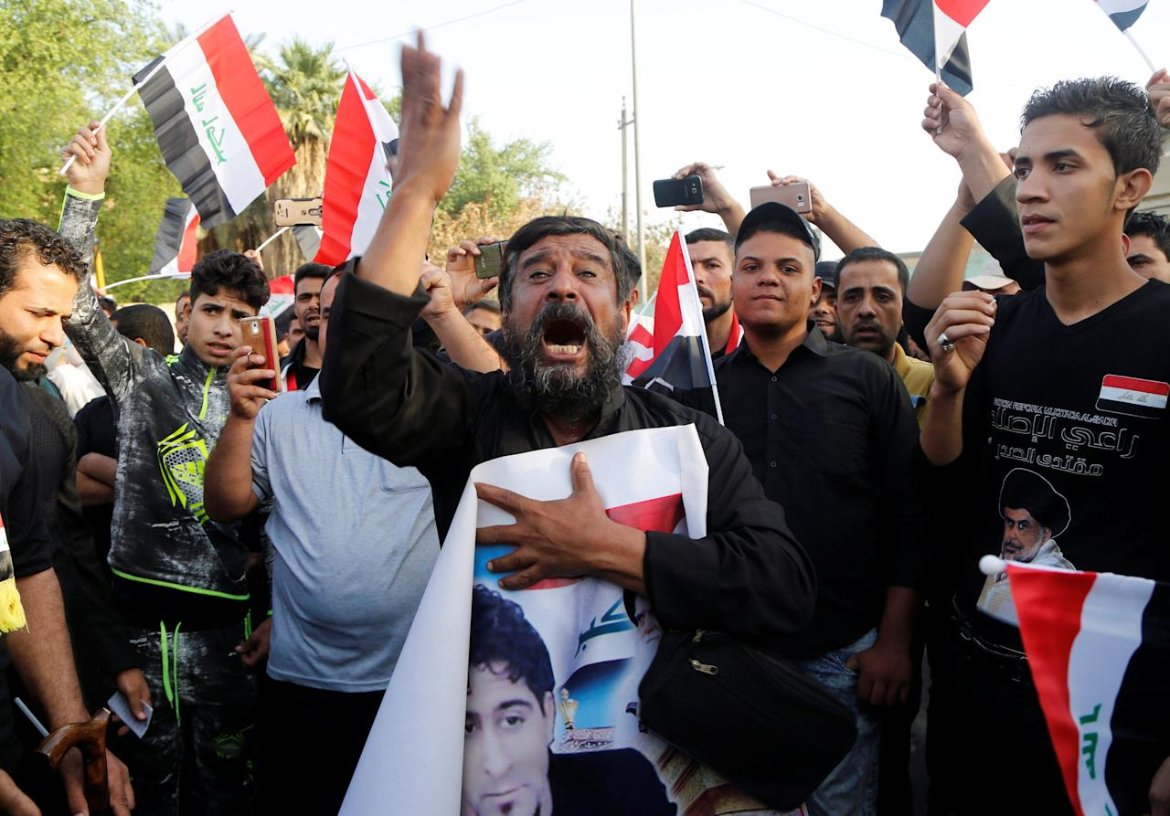 Supporters of Iraqi Shi'ite cleric Moqtada al-Sadr shout slogans during an anti-Turkey protest in front of the Turkish embassy in Baghdad, Iraq October 18, 2016.  REUTERS/Wissm al-Okili