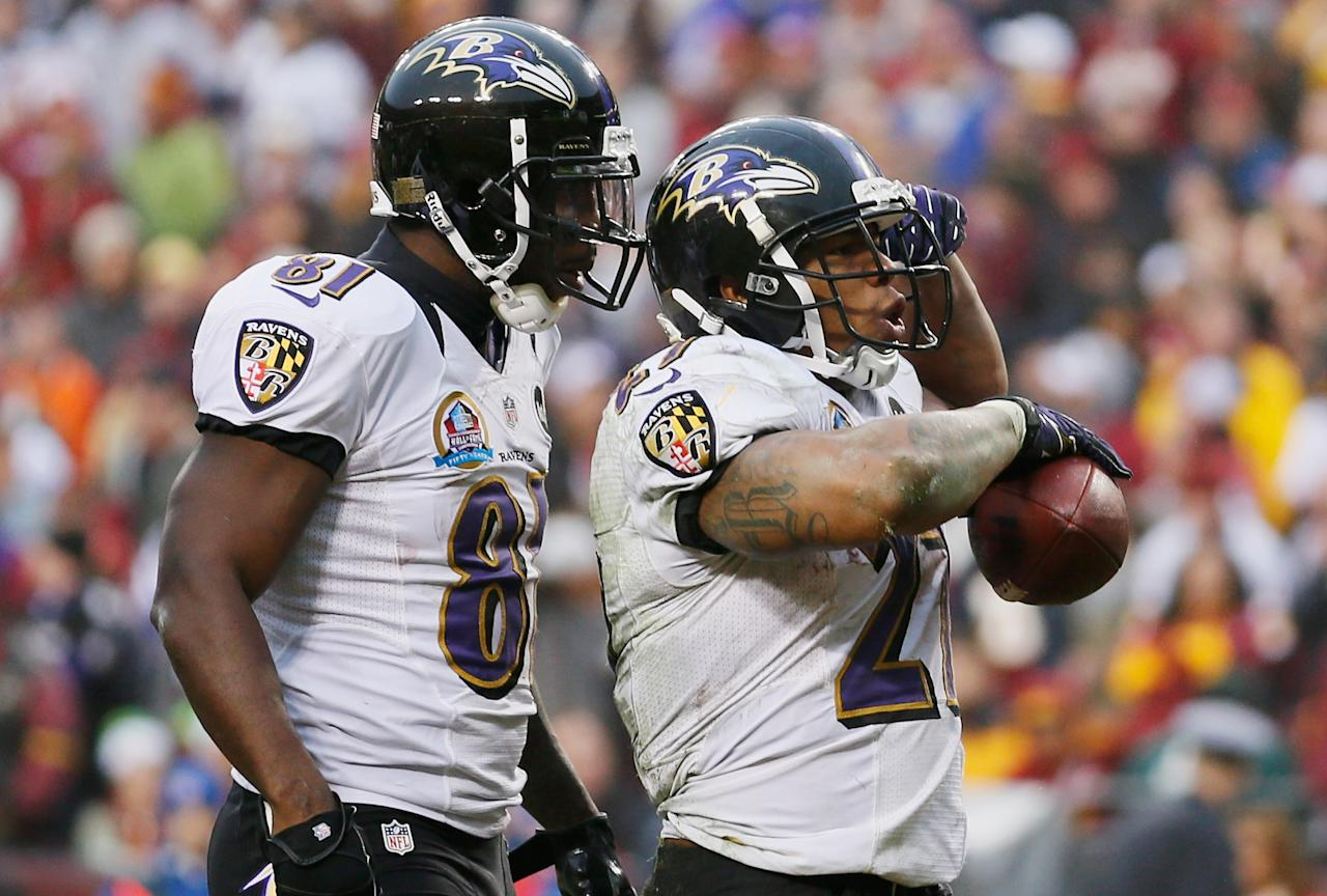 LANDOVER, MD - DECEMBER 09:  Running back Ray Rice #27 of the Baltimore Ravens celebrates with teammate  Anquan Boldin #81 after scoring a touchdown against the Washington Redskins during the fourth quarter of the Ravens 31-28 loss at FedExField on December 9, 2012 in Landover, Maryland.  (Photo by Rob Carr/Getty Images)