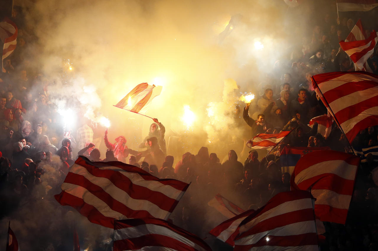 Red Star fans light flares as they cheer for their team during their Serbian Superleague soccer match against Partizan Belgrade in Belgrade, November 17, 2012. REUTERS/Marko Djurica (SERBIA - Tags: SPORT SOCCER TPX IMAGES OF THE DAY)