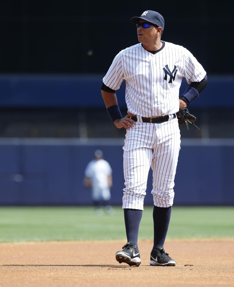 NEW YORK, NY - AUGUST 20: Alex Rodriguez #13 of the New York Yankees stands at third against the Toronto Blue Jays during the first game of a double header at Yankee Stadium on August 20, 2013 in the Bronx Borough of New York City. (Photo by Jeff Zelevansky/Getty Images)