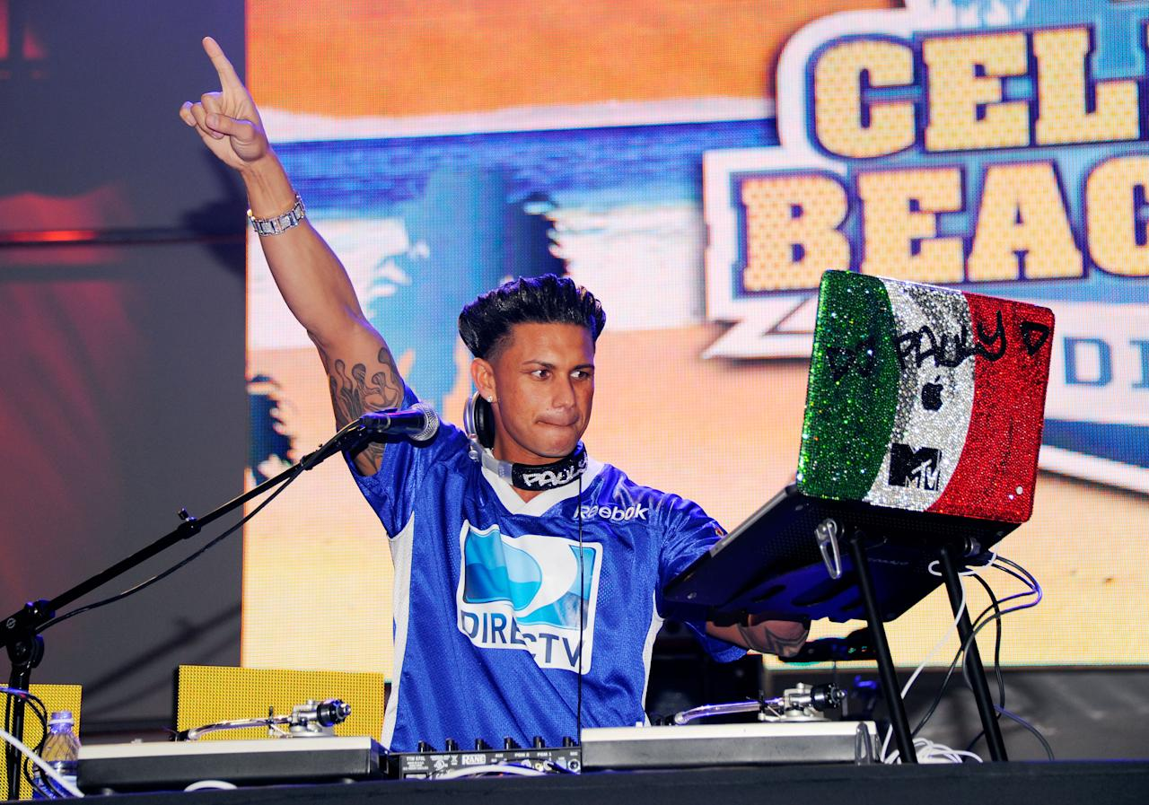 INDIANAPOLIS, IN - FEBRUARY 04:  DJ Pauly D a.k.a. Paul DelVecchio performs during DIRECTV's Sixth Annual Celebrity Beach Bowl Game at Victory Field on February 4, 2012 in Indianapolis, Indiana.  (Photo by Andrew H. Walker/Getty Images for DirecTV)