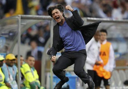 Germany's coach Loew celebrates the team's third goal during the 2010 World Cup quarter-final soccer match against Argentina at Green Point stadium in Cape Town