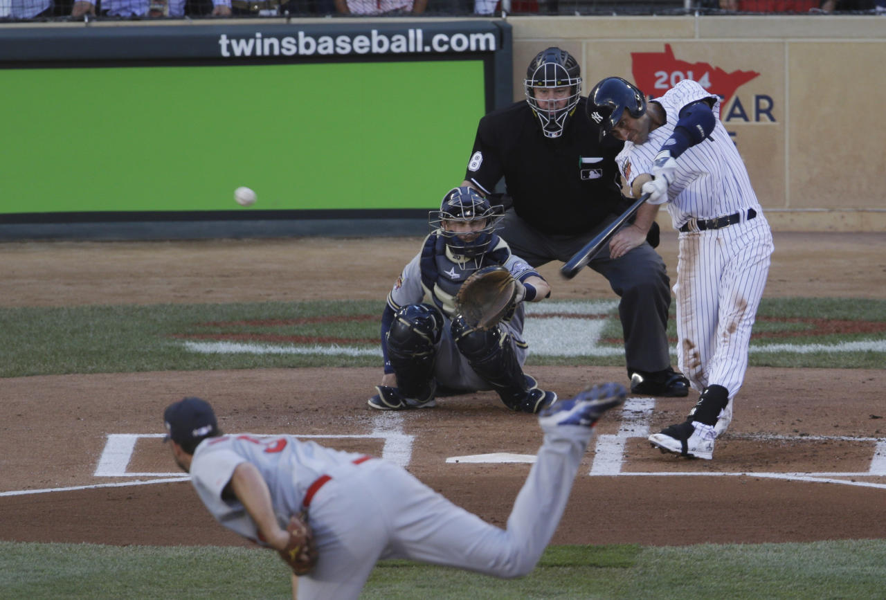 Shortstop Derek Jeter, of the New York Yankees, doubles during the first inning of the MLB All-Star baseball game, Tuesday, July 15, 2014, in Minneapolis. (AP Photo/Paul Sancya)