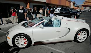 Floyd Mayweather Jr. arrives in his Bugatti for a workout earlier this week. (Getty)
